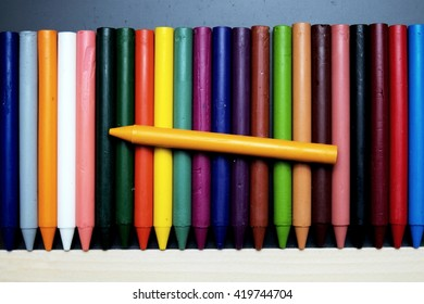 Crayon drawing on blackboard and a yellow at top. Dark tone. Focus on yellow.