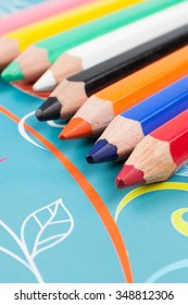 Crayons for drawing on turquoise background