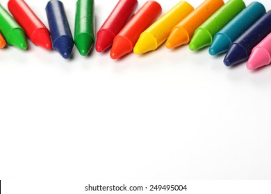 Crayons lying on a paper. Selective focus, copy space background