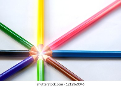 The crayons are on white paper/21st Century Learning/Cooperation in Educational Organizations/Combination of art/Collaboration in Creative Arts/Together, think together, solve problems.