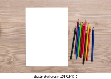 crayons and paper on the desk
