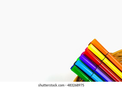 Crayons and pastels lined up isolated on white background