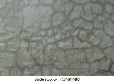 Craze or hairline cracks texture on the surface of raw cement concrete background.