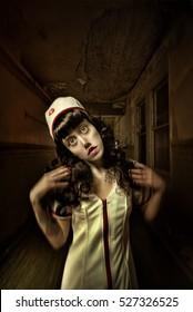 Crazed female zombie nurse walking through the corridor of an old abandoned asylum hospital
