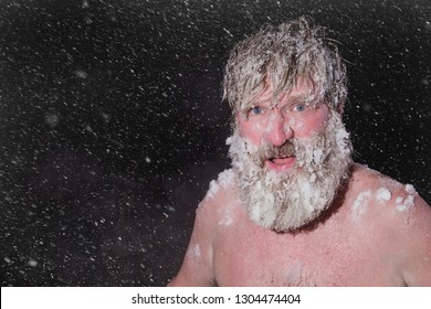 Crazy bearded man ran out of the bath on the snow.