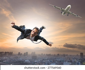 crazy business man flying from passenger plane with glad and happiness emotion use for new trend ,  people traveling ,and top secret strategy