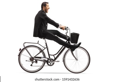 Crazy businessman riding a bicycle with legs up isolated on white background