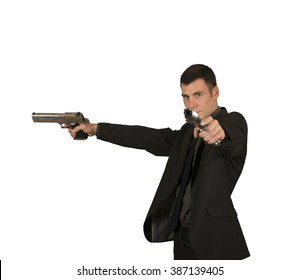 Crazy businessman in suit with two guns