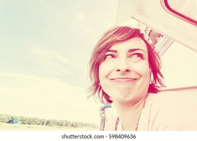 Crazy caucasian woman on the cruise ship. Travelling theme. Female portrait. Vintage filter. Positive emotions.