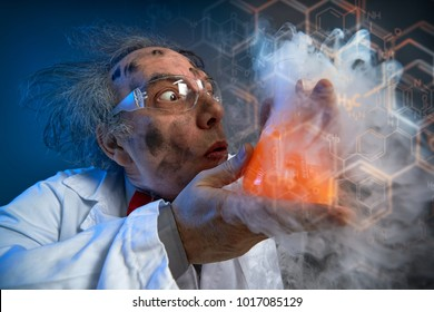 Crazy chemist with dirty face holding  test-tube