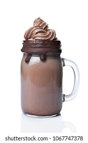 Crazy chocolate milk shake or mocha coffee with whipped cream in glass jar isolated on white background