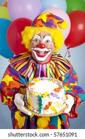 Crazy clown with balloons, holding a birthday cake.