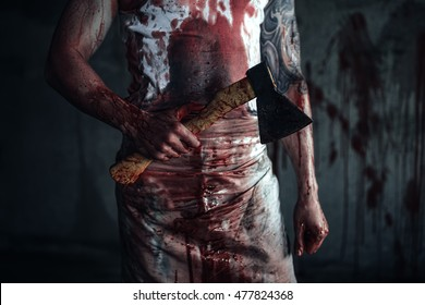 Crazy clown holding an ax in his hands