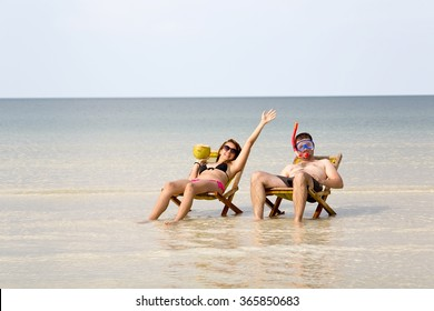 Crazy couple sunbathing, fantastic crystal water, koh rong island, cambodia