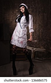 Crazy dead nurse with knife in the hand in a dark room