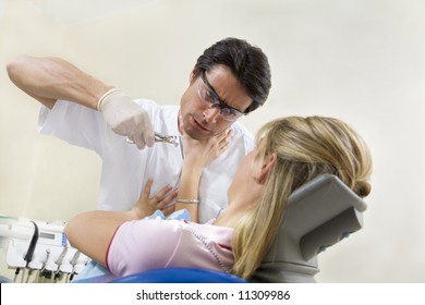 crazy dentist holding forceps and scared patient