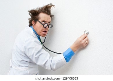 Crazy doctor listening to the stethoscope