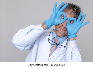 crazy doctor white coat and gloves isolated background