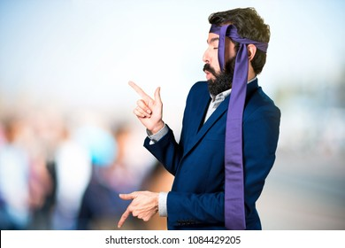 Crazy and drunk businessman dancing on unfocused background