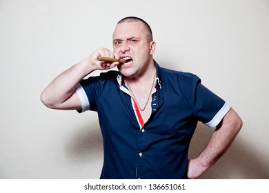 crazy evil man rips his shirt on his hairy chest on a white background with a cigar