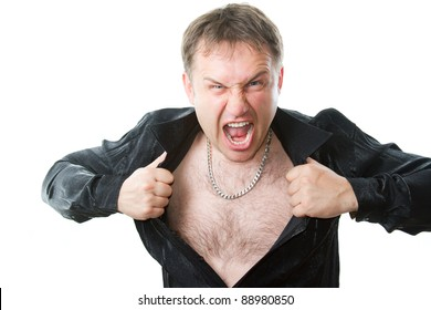 crazy evil man rips his shirt on his hairy chest on a white background