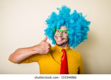 crazy funny young man with blue wig on white background