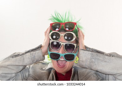 A crazy girl with green hair advertises various styles of glasses. The concept of fun and unexpected advertising.