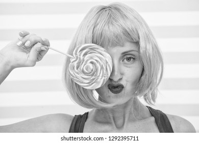 crazy girl holding and playing with lollipop. dieting concept. lollipop dieting. crazy girl love sweet lollipop. candy shop advert. playful girl with crazy look has orange hair and lollipop. dieting