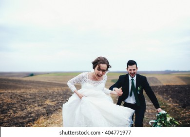 Crazy from happiness couple in the wedding day