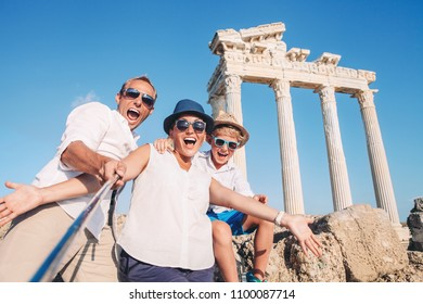Crazy happy family selfie travel photo on the antique colonnade background. Temple of Apollo,Side,Turkey