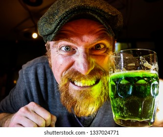 Crazy Irish guy drinks green beer during celebration of St Patrick's day or night