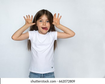 Crazy little girl show tongue, isolated on white background