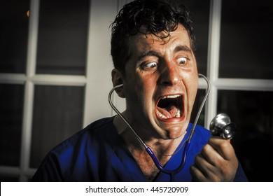 Crazy lunatic male nurse yells into his own stethoscope