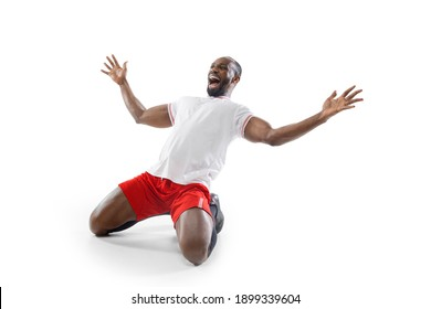 Crazy, mad happiness. Funny emotions of professional football, soccer player isolated on white studio background. Excitement in game, human emotions, facial expression and passion with sport concept.