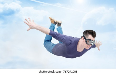 Crazy man in goggles is flying in the cloudy sky. Jumper concept