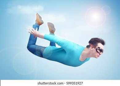 Crazy man in goggles is flying in the sky. Jumper concept