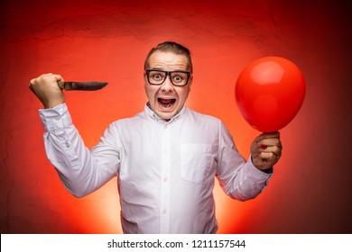 Crazy man going to burst the ballon. Stress concept.