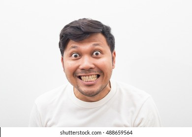 crazy  man happy pose.Man wearing a white T-shirt