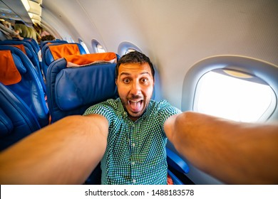 crazy man happy take selfie in the airplane scared about flight