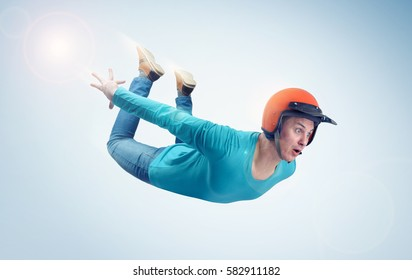Crazy man in red helmet is flying in the sky. Jumper concept