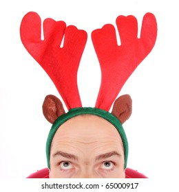 Crazy man with reindeer attire - head closeup. Funny image great for christmas and new year greeting card.