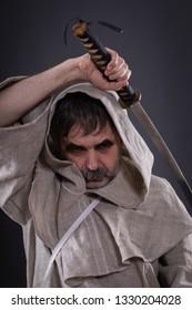 Crazy monk threaten with katana