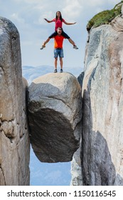 Crazy partner piggybacking his lady, she rides him romantic trip in Norway Kjerag mountains vacations adventure lifestyle family man and woman together extreme journey concept.