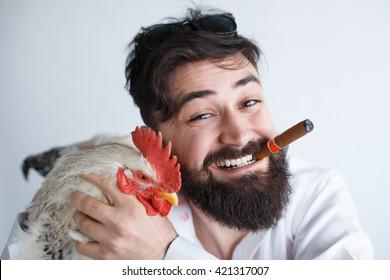 Crazy party concept. Comic bearded man hugs his new strange friend.