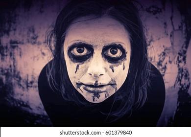 Crazy psycho girl on city street