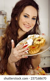 crazy real woman housewife on kitchen smiling eating