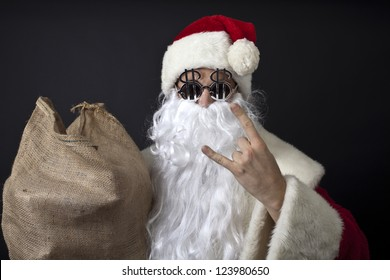 Crazy santa claus with dollar glasses