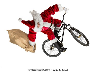 crazy santa claus jump on dirt mountain bike with jute burlap bag isolated abstract christmas funny sport white background