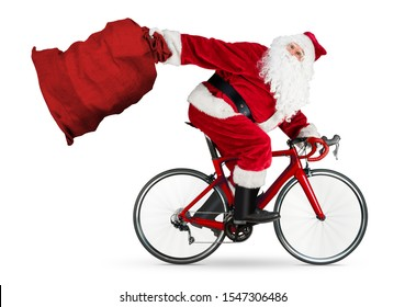 crazy santa claus rushing fast in a hurry late on road racer racing carbon bicycle with big huge jute bag with copy space isolated on white funny christmas background