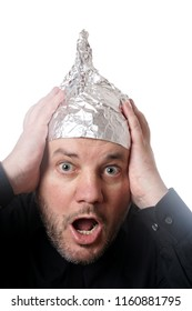 crazy scared man wearing tin foil hat, paranoia or conspiracy theory concept